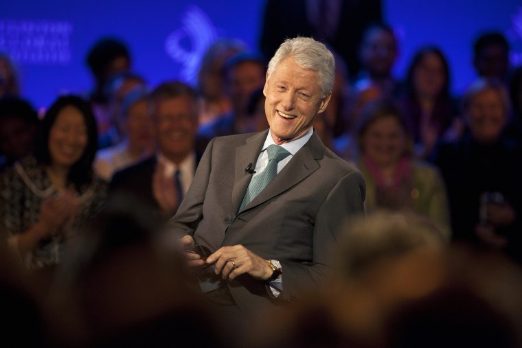 Former U.S. President Bill Clinton smiles during a taping in New York City, Sept. 25, 2013.