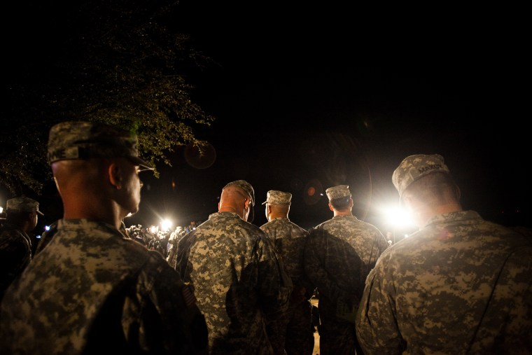 Soldiers watch during a press conference about a shooting that occurred earlier in the day at Fort Hood Military Base on April 2, 2014.