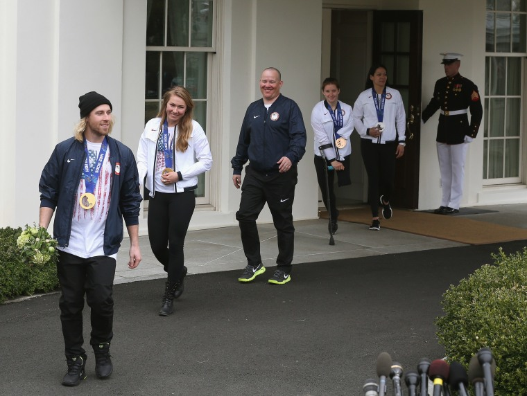 U.S. Olympian Sage Kostenberg, Olympian Mikaela Shifrin, Paralympian Jon Lujan, Paralympian Stephanie Jallen and Olympian Julie Chu walk out of the West Wing to speak to the media while visiting the White House, on April 3, 3014 in Washington, DC.