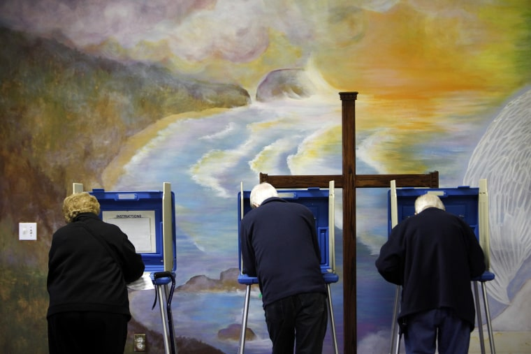 Voters cast ballots at the Fellowship of Christ church in Cary, N.C.