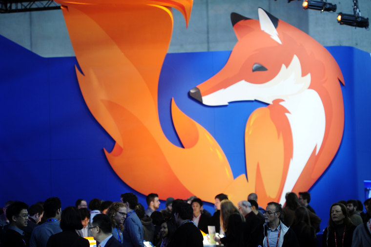 People gather in the Firefox booth at the Mobile World Congress, the world's largest mobile phone trade show in Barcelona, Spain, Feb. 27, 2014.