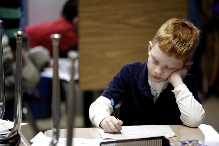 A second grader at George Buck Elementary School in Indianapolis, works on writing, March 25, 2014.