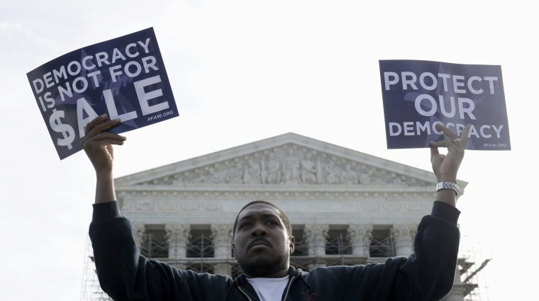 Cornell Woolridge takes part in a demonstration outside the Supreme Court in Washington as the court heard arguments on campaign finance, October 8, 2013.