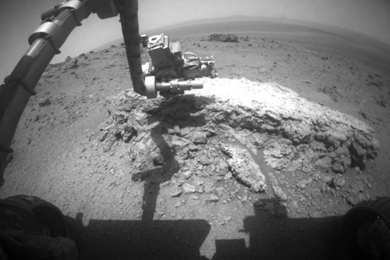 This image provided Thursday Sept. 1, 2011 by NASA shows NASA's Mars Exploration Rover Opportunity using its camera to take this picture showing the rover's arm extended, Aug. 21, 2011.