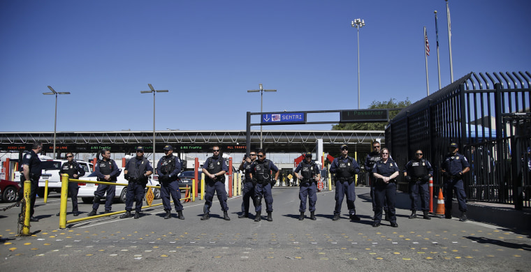 U.S. Customs and Border Protection officers block entry lanes into the United States as the group Border Dreamers and othersmarch toward the U.S. border, March 10, 2014, in Tijuana, Mexico.