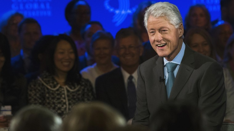 Former U.S. President Bill Clinton (R) laughs during an interview at the Clinton Global Initiative (CGI) in New York September 25, 2013.