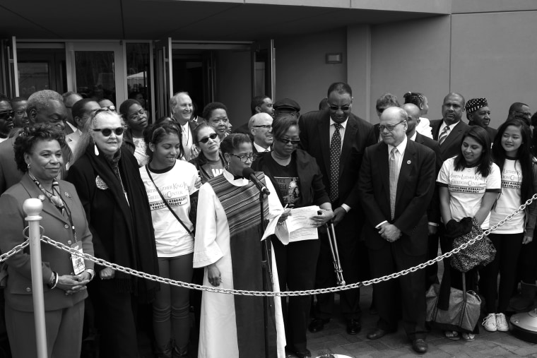 Officials break the chain signifying the reopening of the National Civil Rights Museum, April 5, 2014, in Memphis, Tenn.