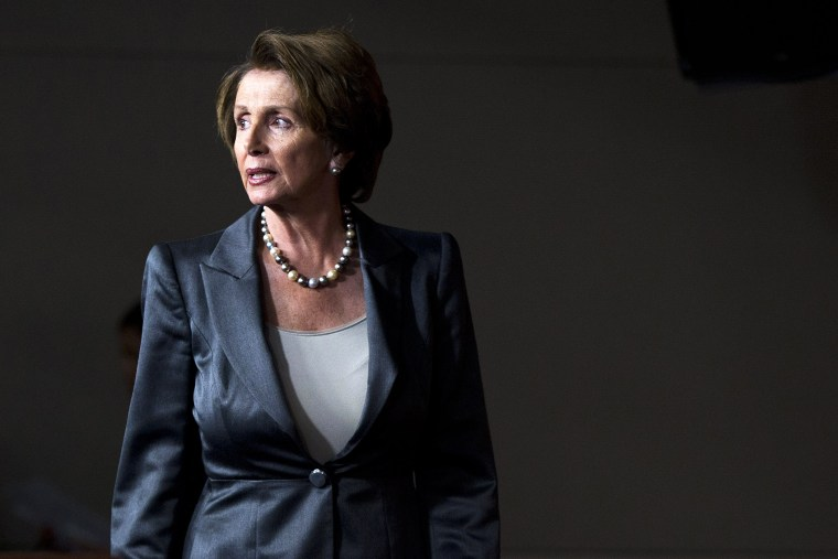 House Minority Leader Nancy Pelosi (D-Calif.) arrives for a news conference, Oct. 3, 2013, on Capitol Hill in Washington.