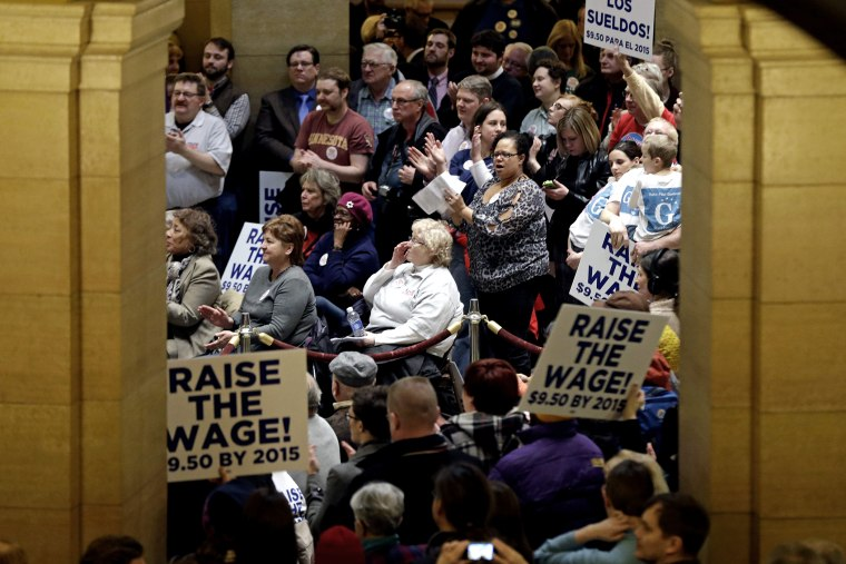 Demonstrators rally at the Minnesota State Capitol in favor of raising the minimum wage on Feb. 25, 2014, in St. Paul, Minn.