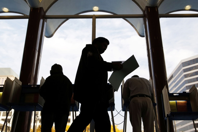 Milwaukee residents cast their ballots during early voting at the Milwaukee Municipal Building Oct. 22, 2012 Milwaukee, Wis.
