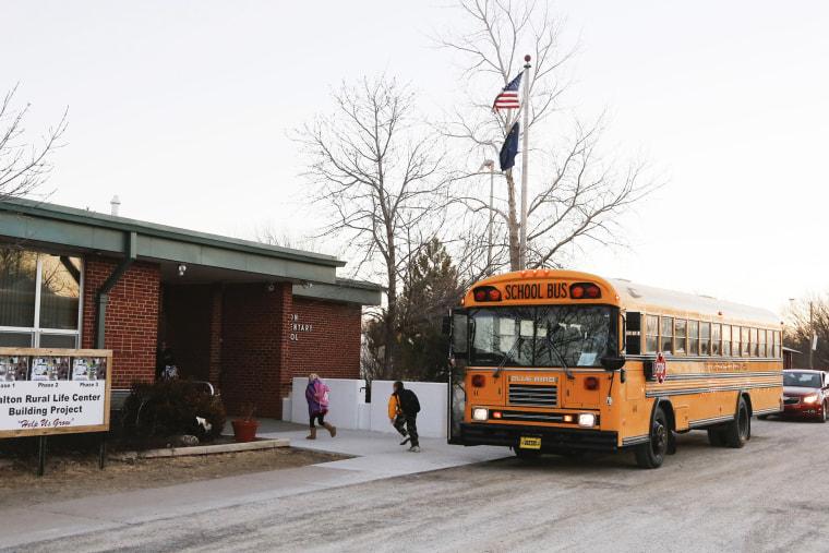 Students arrive at the Walton Rural Life Center Elementary School, in Walton, Kansas, January 18, 2013.
