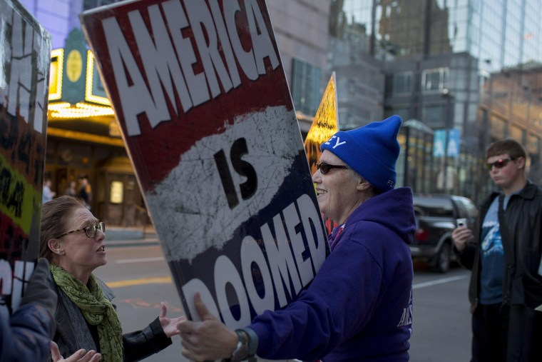 Barbara Moore, left, questions Westboro Church Member Shirley Phelps-Roper during a protest outside a Young the Giant concert at The Midland, Kansas City, Mo., March 19, 2014.