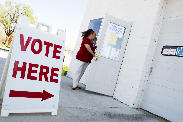 A Voter enters the fire station polling place in Magnolia, Illinois,  March 20, 2012.