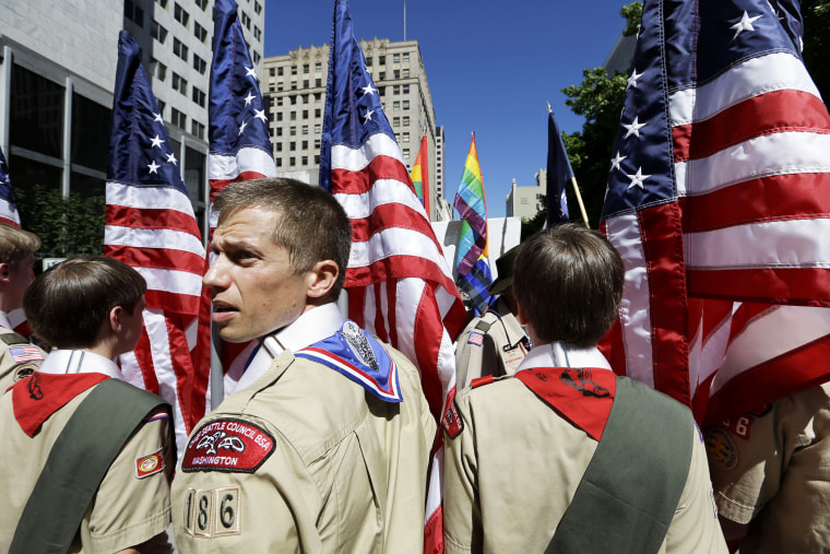 Boy Scouts from the Chief Seattle Council carry U.S. flags as they prepare to march in the Gay Pride Parade in downtown Seattle, June 30, 2013.