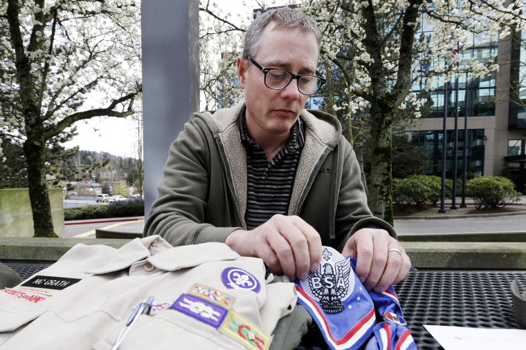 Geoff McGrath displays his Boy Scout scoutmaster uniform shirt and other scout items for the Seattle troop he led, April 1, 2014.