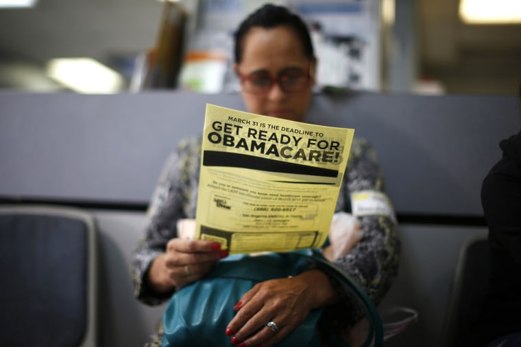 Arminda Murillo, 54, reads a leaflet at a health insurance enrollment event in Cudahy, Calif., March 27, 2014.