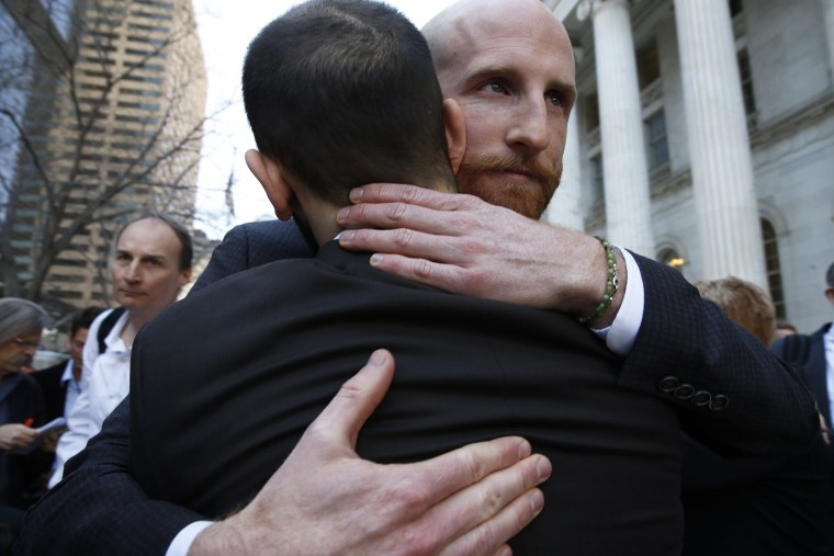 Derek Kitchen, right, and his partner Moudi Sbeity, the plaintiffs challenging Utah's gay marriage ban, hug after leaving court following a hearing at the U.S. Circuit Court of Appeals in Denver, April 10, 2014.