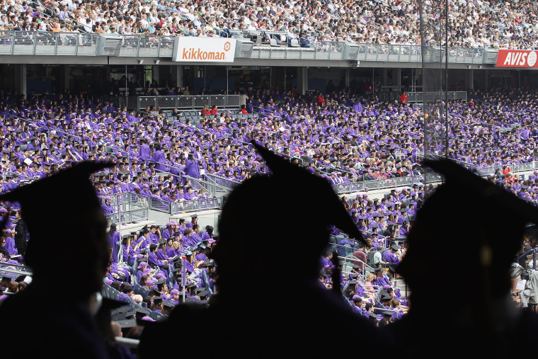 Graduating students attend New York University's commencement ceremony, May 16, 2012 in New York, N.Y.
