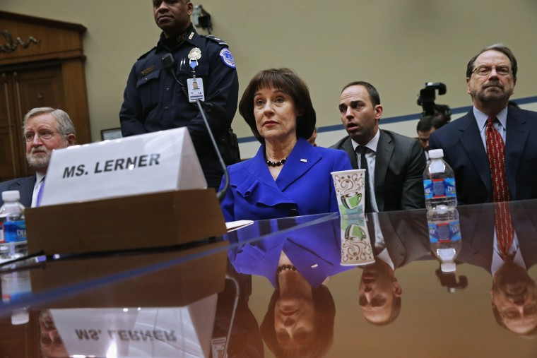 Former Internal Revenue Service official Lois Lerner (C) exercises her Fifth Amendment right not to speak about the IRS targeting investigation, March 5, 2014.