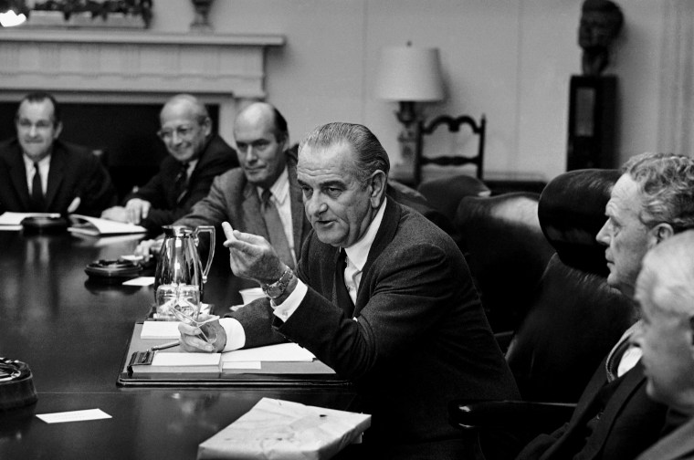 President Lyndon Johnson meets in the White House Cabinet Room with top military and defense advisers on Oct. 31, 1968 in Washington.