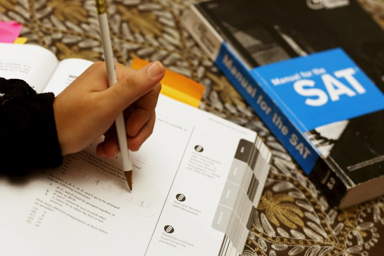 A student uses a Princeton Review SAT Preparation book to study for the test, March 6, 2014, in Pembroke Pines, Fla.