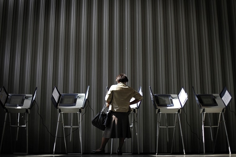 A woman casts her ballot during early voting, Oct., 26, 2010, in Atlanta, Ga.