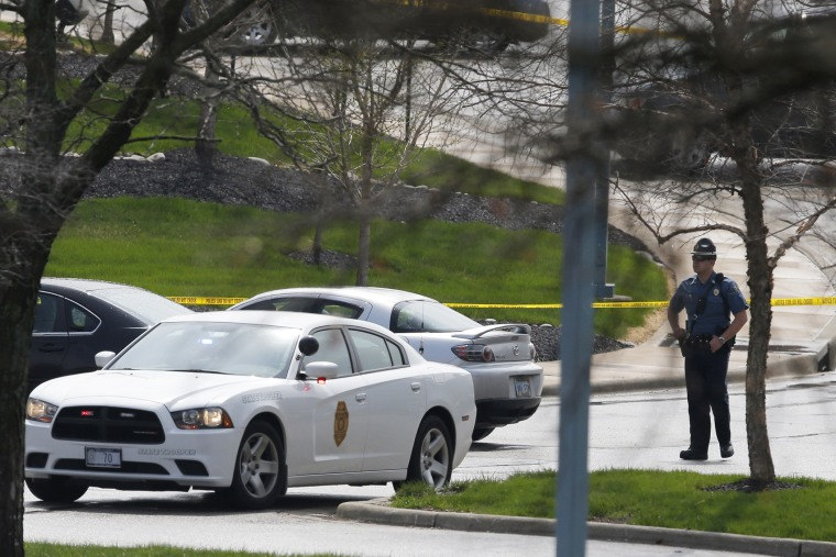 A Kansas State Trooper stands near the location of a shooting at the Jewish Community Center in Overland Park, Kan., April 13, 2014.