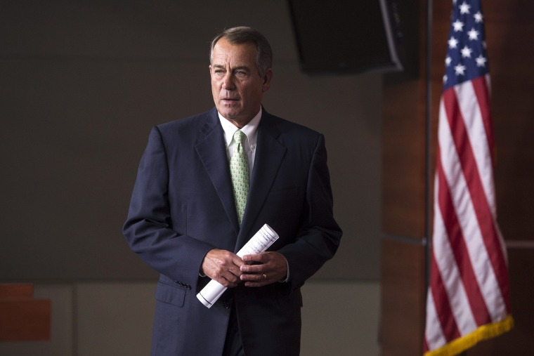 John Boehner walks to the podium to hold a news conference, on Capitol Hill, April 10, 2014.