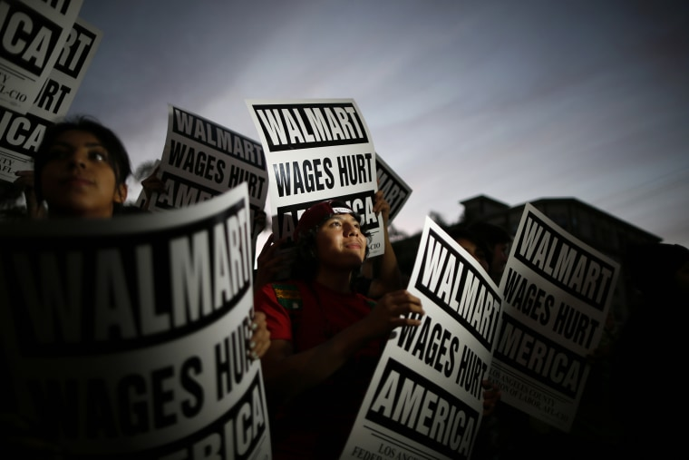 Pedro Taverna takes part in a protest for better wages at which 54 people were arrested outside Wal-mart in Los Angeles