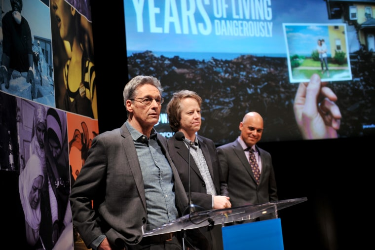"Executive producers David Gelber, Joel Bach and Daniel Abbasi speak onstage during the Showtime screening of ""Years Of Living Dangerously"" in New York City, April 9, 2014."
