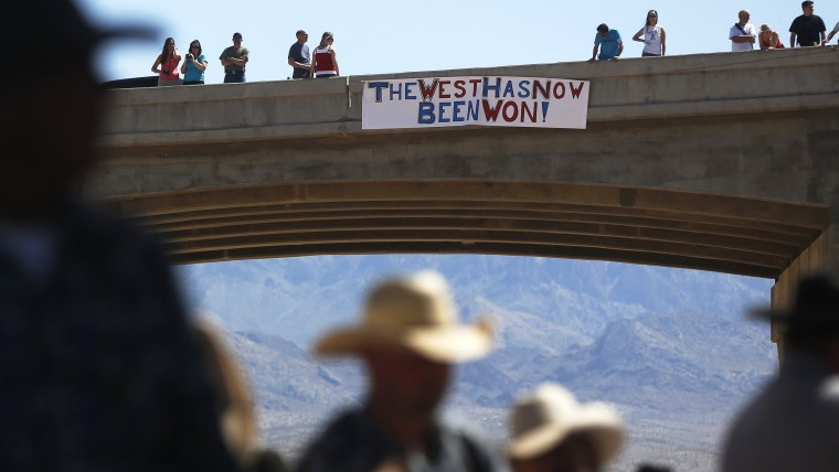 Image: Protesters place a sign on a bridge near the Bureau of Land Management 's base camp where seized cattle, that belonged to rancher Cliven Bundy, are being held at near Bunkerville