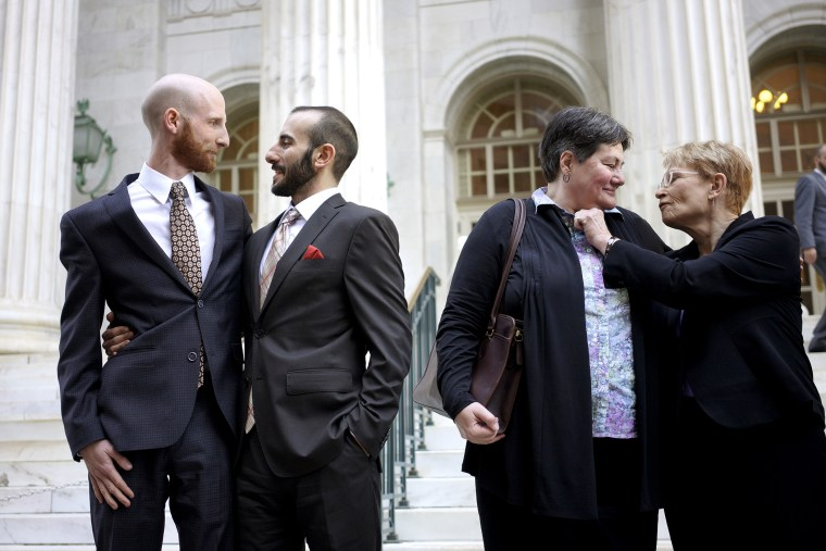 Plaintiffs talk outside the courthouse after a federal appeals court heard oral arguments on a Utah state law forbidding gays and lesbians from marrying in Denver