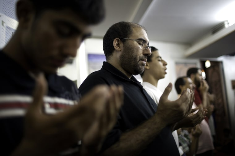 Muslim-American men offer evening prayers after breaking their day-long Ramadan fast on Aug. 24, 2011 at Islamic Center of Bay Ridge in the Brooklyn borough of New York.