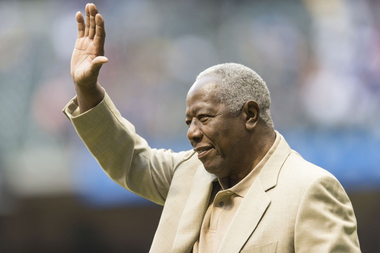 Baseball Hall of Famer Hank Aaron waves to the crowd before the start of the Washington Nationals game at Miller Park on Aug. 2, 2013 in Milwaukee, Wisc.