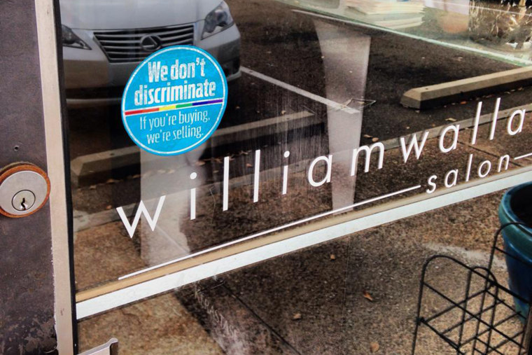 "A sticker outside the Williams Wallace Salon in Jackson, Miss. promoting the ""If You're Buying, We're Selling"" campaign"