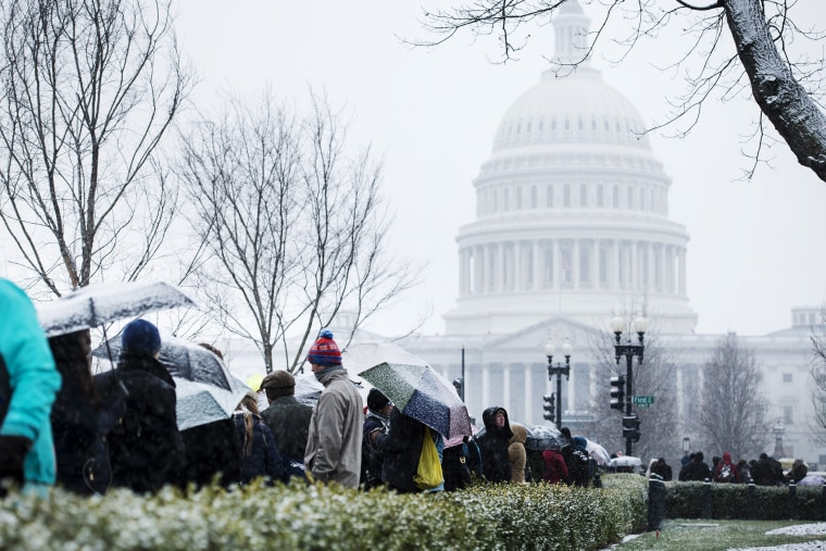 People stand outside the US Supreme Court, Mar. 25, 2014.