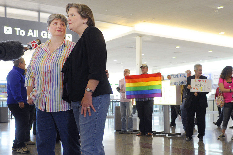 Sharon Baldwin, left, and her partner Mary Bishop speak with members of the media before boarding a plane to Denver at Tulsa International Airport, on April 16, 2014.