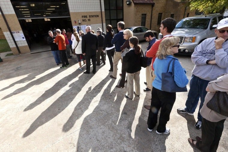 Voters wait in line outside a fire station being used as a polling place in Little Rock, Ark., on Nov. 6, 2012.