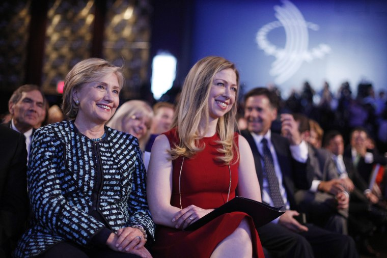Former Secretary of State Hillary Rodham Clinton, left, and her daughter Chelsea Clinton, center, at the  Clinton Global Initiative in New York, Sept. 24, 2013.