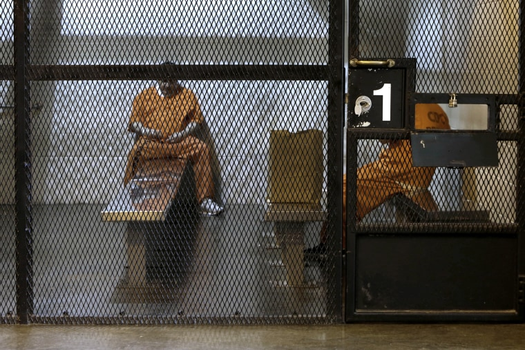 New arrivals wait to be assigned to cells at the Deuel Vocational Institution in Tracy, Calif. on Feb. 20, 2014.