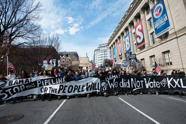 Students protesting against the proposed Keystone XL pipeline march near the White House in Washington, D.C. on March 2, 2014.