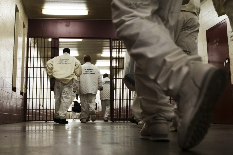 Inmates at William E. Donaldson prison in Bessemer, Ala., return to their cells.