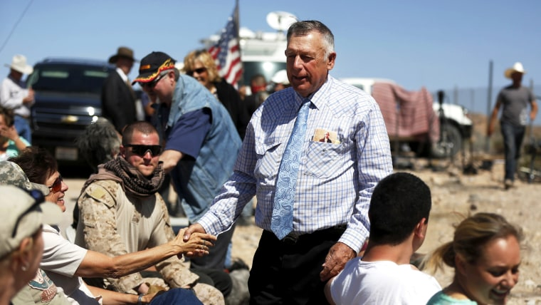 Rancher Cliven Bundy greets supporters before a roadside church service at a protest site in Bunkerville April 13, 2014.