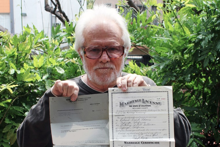 Anthony Sullivan holds the original INS denial letter from November 24, 1975 and original marriage certificate from April 21, 1975.