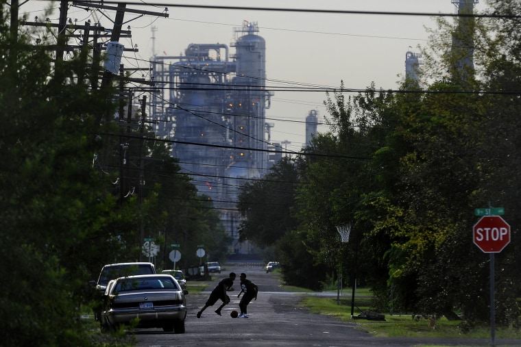 Oil facilities loom in the background of  Port Arthur, Texas, which is the end of the line for oil that would travel through the proposed Keystone XL Pipeline.