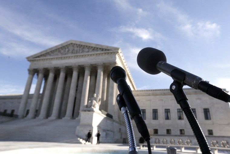 Microphones are set up in front of the U.S. Supreme Court in Washington on Jan. 13, 2014.