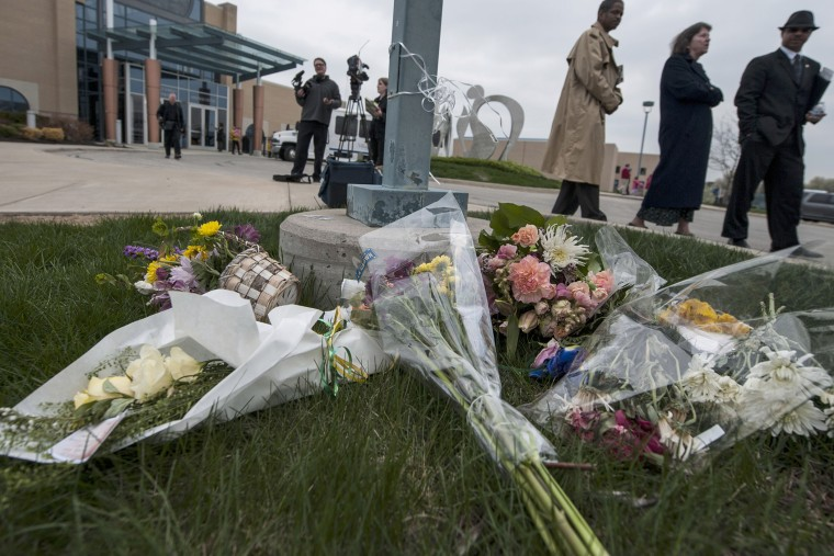 Crowds pass by a makeshift memorial following an interfaith service April 17, 2014 honoring victims of the shootings in Overland Park, Kansas.