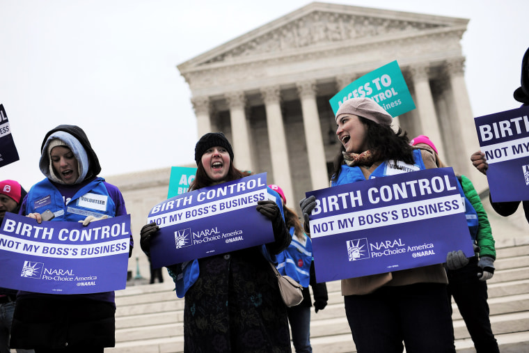 Demonstrators rally while the Supreme Court hears arguments on aspects of the Affordable Care Act involving a mandate for contraception, March 25, 2014.