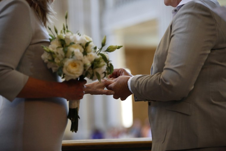 A couple exchange wedding rings at City Hall in San Francisco, on June 28, 2013.