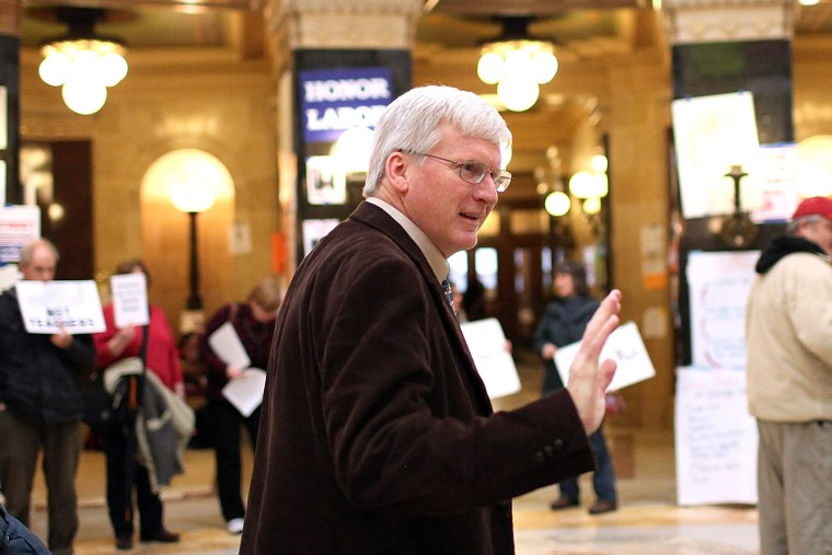 Republican Wisconsin State Senator Glenn Grothman waves as he walks through the Wisconsin State Capitol on March 4, 2011 in Madison,Wisconsin.